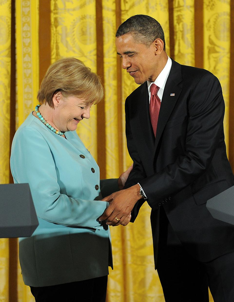 U.S. President Barack Obama shakes hands with German Chancellor Angela Merkel after a joint press conference following their meeting in the East Room of the White House in Washington, D.C., on June 7, 2011.