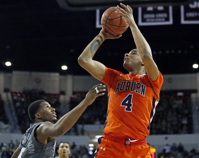 Auburn forward Chuma Okeke (4) shoots over a defending Mississippi State guard Nick Weatherspoon (0) during the second half of an NCAA college basketball game in Starkville, Miss., Saturday, Jan. 13, 2018. Auburn won 76-68. (AP Photo/Rogelio V. Solis)