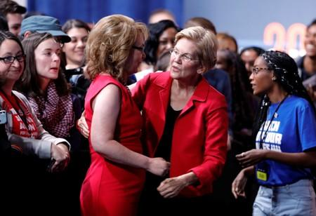 U.S. Democratic presidential candidate Senator Warren (D-MA) embraces former Arizona Congresswoman Giffords after speaking at a forum held by gun safety organizations the Giffords group and March For Our Lives in Las Vegas