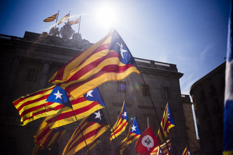 Catalan Independence supporters wave esteladas