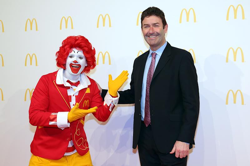 FRANKFURT AM MAIN, GERMANY - MARCH 30: Steve Easterbrook, CEO McDonald, poses with Ronald McDonald during the new McDonald's Flagship Restaurant re-opening at Frankfurt International Airport, Terminal 2, on March 30, 2015 in Frankfurt am Main, Germany. (Photo by Hannelore Foerster/Getty Images)