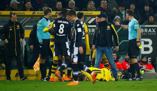 Soccer Football - Bundesliga - Borussia Moenchengladbach vs Borussia Dortmund - Borussia-Park, Moenchengladbach, Germany - February 18, 2018 Borussia Dortmund coach Peter Stoeger reacts as Marco Reus lies injured REUTERS/Thilo Schmuelgen DFL RULES TO LIMIT THE ONLINE USAGE DURING MATCH TIME TO 15 PICTURES PER GAME. IMAGE SEQUENCES TO SIMULATE VIDEO IS NOT ALLOWED AT ANY TIME. FOR FURTHER QUERIES PLEASE CONTACT DFL DIRECTLY AT + 49 69 650050