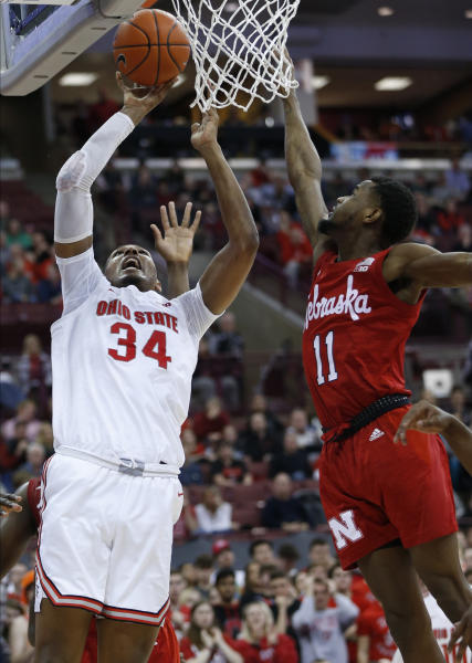 Ohio State's Kaleb Wesson, left, takes a shot against Nebraska's Dachon Burke during the second half of an NCAA college basketball game Tuesday, Jan. 14, 2020, in Columbus, Ohio. Ohio State defeated Nebraska 80-68. (AP Photo/Jay LaPrete)