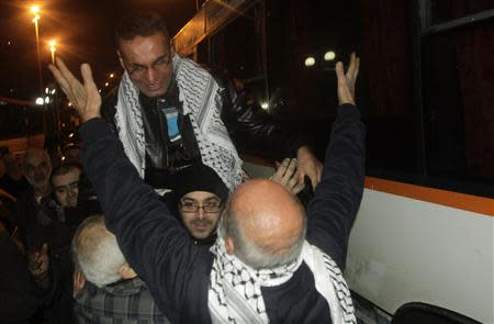 Newly released prisoner Taktook is greeted upon his arrival at his home in Nablus