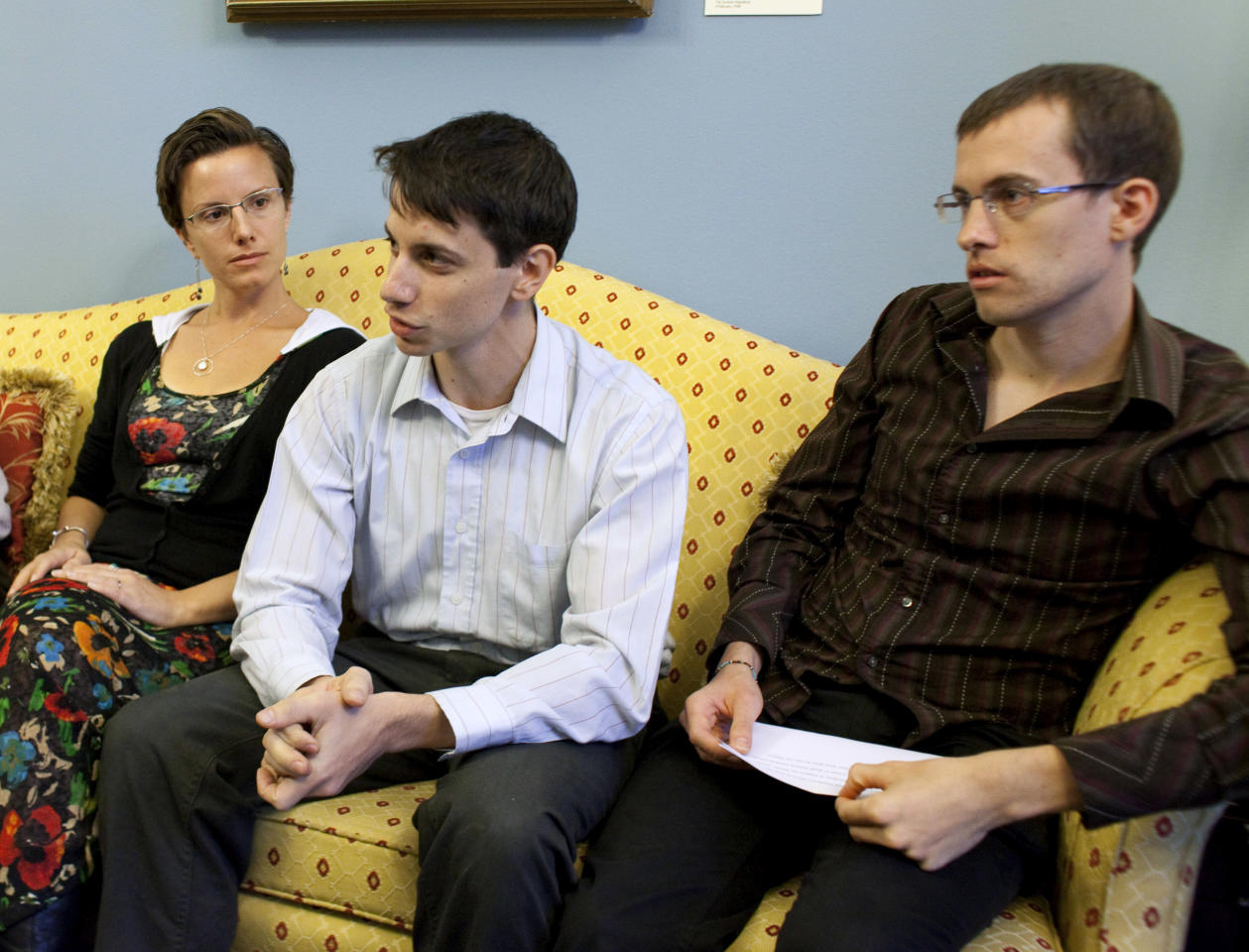 From left, Sarah Shourd, Josh Fattel and Shane Bauer , hikers who was imprisoned in Iran, center, meet with Sen. Al Franken, D-Minn., and Sen. Robert Casey, D-Pa., Not shown, Wednesday, Oct. 12,2011, on Capitol Hill in Washington, Wednesday, Oct. 12, 2011. (AP Photo/Harry Hamburg)
