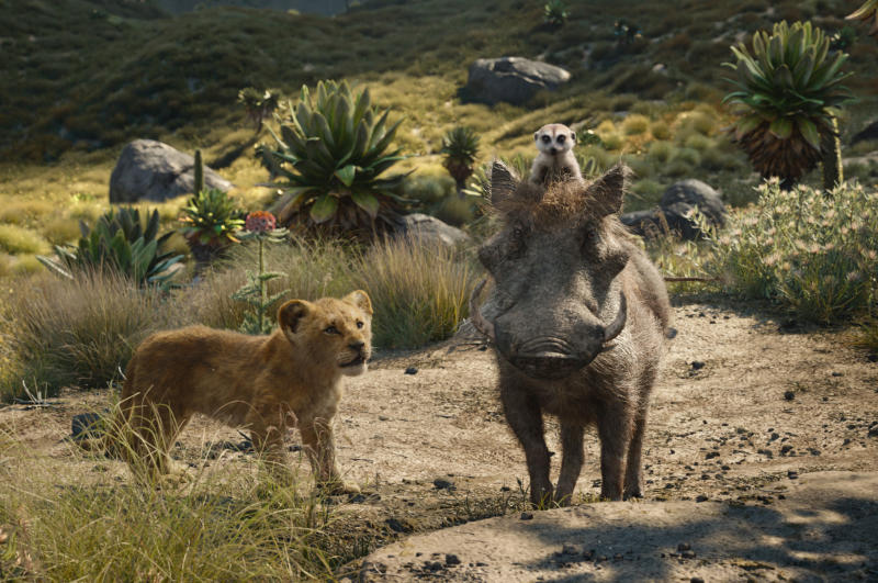 "FILE - This file image released by Disney shows, from left, young Simba, voiced by JD McCrary, Timon, voiced by Billy Eichner, and Pumbaa, voiced by Seth Rogen, in a scene from ""The Lion King."" The Walt Disney Co. is ruling the box office again with the record-breaking debut of ""The Lion King"" this weekend. The studio says Sunday, July 21, 2019 that the photorealistic remake devoured an estimated $185 million in ticket sales from 4,725 North American locations. It's a record for the month of July, PG-rated films and the ninth highest opening of all time.(Disney via AP, File)"
