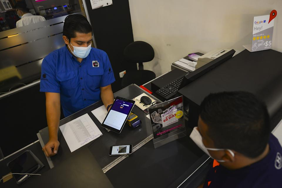 SAN SALVADOR, EL SALVADOR - SEPTEMBER 09: Salvadoran workers, businessmen and merchants begin payment and collection operations in the state Bitcoins wallet