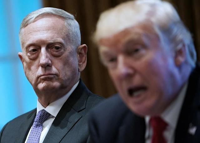 Former US defense secretary Jim Mattis (L), seen here with President Donald Trump in 2017, has come out swinging against his former boss (AFP Photo/MANDEL NGAN)