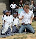<p>Harry dances with children during at visit to the Kananelo Centre for the deaf in Maseru, Lesotho. </p>