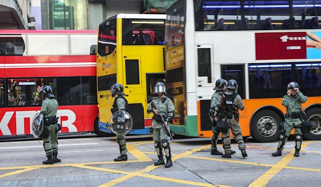 Riot police watch traffic conditions on Nathan Road in Mong Kok. Photo: Sam Tsang