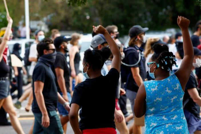 FILE PHOTO: People march from Aurora to Denver to protest against inequality and police violence