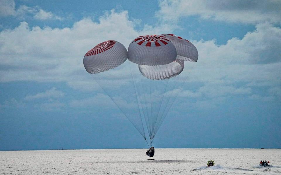 The capsule carrying four people parachutes into the Atlantic Ocean off the Florida coast - SpaceX