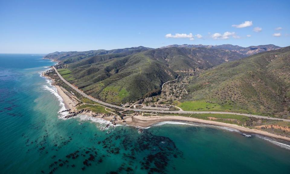 Aerial view of the Pacific Coast Highway as it runs past Leo Carrillo state park in Malibu, California.