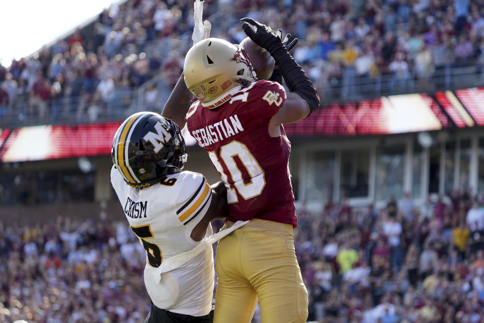 Boston College defensive back Brandon Sebastian (10) intercepts a pass intended for Missouri wide receiver Keke Chism (6) to win the game in the overtime period of an NCAA college football game, Saturday, Sept. 25, 2021, in Boston. (AP Photo/Mary Schwalm)