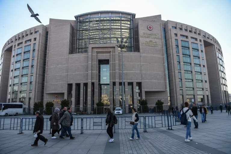 Turkish police escorted Topuz into the Caglayan courthouse in Istanbul, where he faces life in jail if found guilty