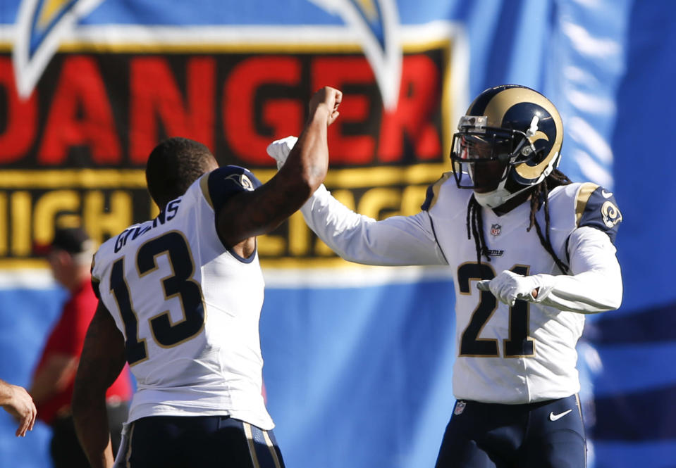 St. Louis Rams cornerback Janoris Jenkins, right, celebrates his touchdown with teammate Chris Givens during the first half of an NFL football game against the San Diego Chargers, Sunday, Nov. 23, 2014, in San Diego. (AP Photo/Lenny Ignelzi)