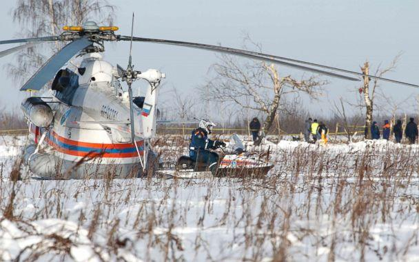 PHOTO: Russian Emergency Situations Ministry employees and Russian police officers work at the scene of a AN-148 plane crash in Stepanovskoye village, about 40 kilometers (25 miles) from the Domodedovo airport, Russia, on Feb. 12, 2018. (Alexander Zemlianichenko/AP)
