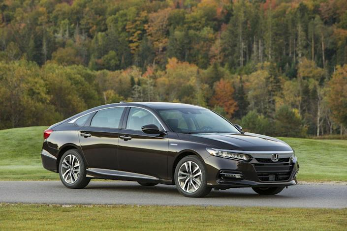 """<p>Honda's Accord is a perennial favorite of ours—witness its record 33 10Best Cars awards from us—so naturally, <a href=""""https://www.caranddriver.com/honda/accord"""" rel=""""nofollow noopener"""" target=""""_blank"""" data-ylk=""""slk:the 2019 Honda Accord Hybrid"""" class=""""link rapid-noclick-resp"""">the 2019 Honda Accord Hybrid</a> is one of our top picks among a hybrid sedans. The Accord feels solid, gets up to speed quickly, and remains quiet at cruising speeds. You'd never know how clever its hybrid system is, but you'll appreciate the EPA's 48-mpg combined rating. That figure is not bad for a hybrid this big and refined.<br></p>"""