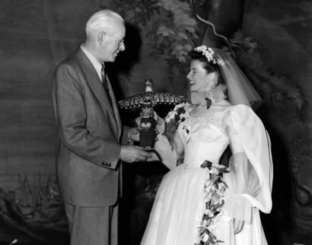 Actress Katherine Hepburn receives a totem pole carved by Ellen Neel from Harry Duker of the Totem Land Society.