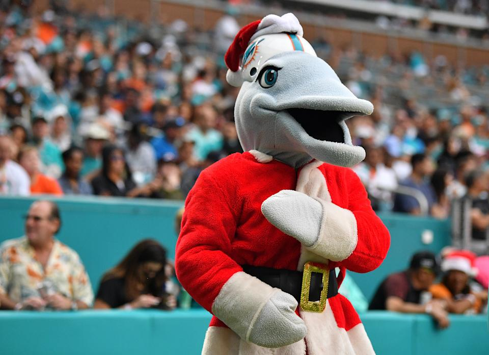 MIAMI, FLORIDA - DECEMBER 22: The Miami Dolphins mascot performs as Santa Clause during the game against the Cincinnati Bengals in the first quarter at Hard Rock Stadium on December 22, 2019 in Miami, Florida. (Photo by Mark Brown/Getty Images)