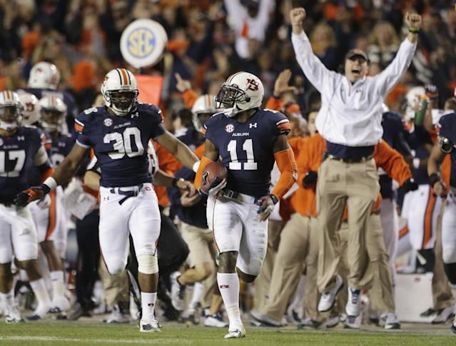 Auburn cornerback Chris Davis (11) returns a missed field-goal attempt 100-plus yards to score the game-winning touchdown as time expired in the fourth quarter of an NCAA college football game against No. 1 Alabama in Auburn, Ala., Saturday, Nov. 30, 2013. Auburn won 34-28. (AP Photo/Dave Martin)