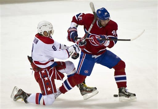 Washington Capitals' Alex Ovechkin,l eft, and Montreal Canadiens' Andrei Kostitsyn battle for the puck during first period NHL hockey action, Saturday, Feb. 4, 2012 in Montreal. (AP Photo/The Canadian Press, Paul Chiasson)