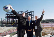 FILE - National Football League commissioner Paul Tagliabue, left, points to construction on the new New England Patriots football stadium as he examines the structure along with Patriots' owner Robert Kraft, center, and construction project director Terry McManus, right, at the site in Foxboro, Mass., in this Sunday, Nov. 19, 2000, file photo. During Tagliabue's 17-year stint as commissioner, the NFL experienced labor peace, saw skyrocketing television deals, construction of new stadiums across the nation, and expansion to the current 32-team makeup.(AP Photo/Jim Rogash, File)
