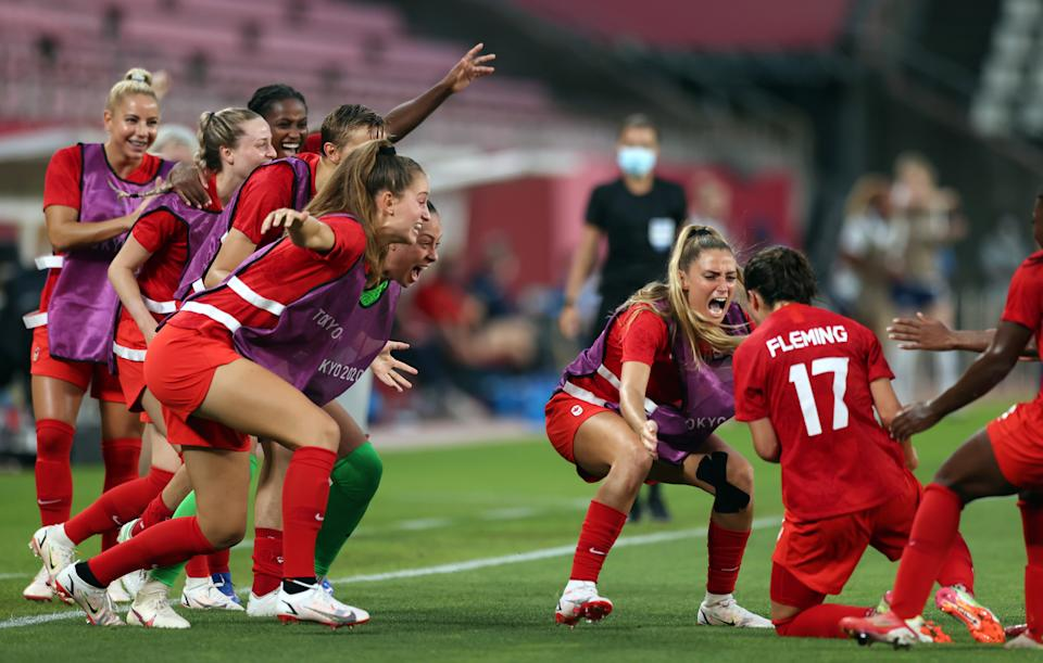 KASHIMA, JAPAN - AUGUST 02: Players of Team Canada celebrate their side's first goal scored by Jessie Fleming #17 of Team Canada during the Women's Football Semifinal match between USA and Canada at Kashima Stadium on August 02, 2021 in Kashima, Ibaraki, Japan. (Photo by Naomi Baker/Getty Images)