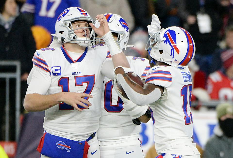 John Brown celebrates with Josh Allen by pretending to drink.