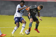 Los Angeles Galaxy Chichartio, right, battles with Vancouver Whitecaps defender Javain Brown, left, in the first half during an MLS soccer match Wednesday, June 23, 2021, in Sandy, Utah. (AP Photo/Rick Bowmer)