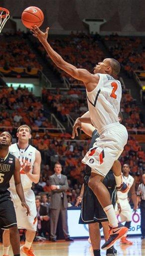 Illinois' Joseph Bertrand (2) shoots against Purdue during the first half of their NCAA college basketball game, Wednesday, Feb. 13, 2013, in Champaign, Ill. (AP Photo/Darrell Hoemann)
