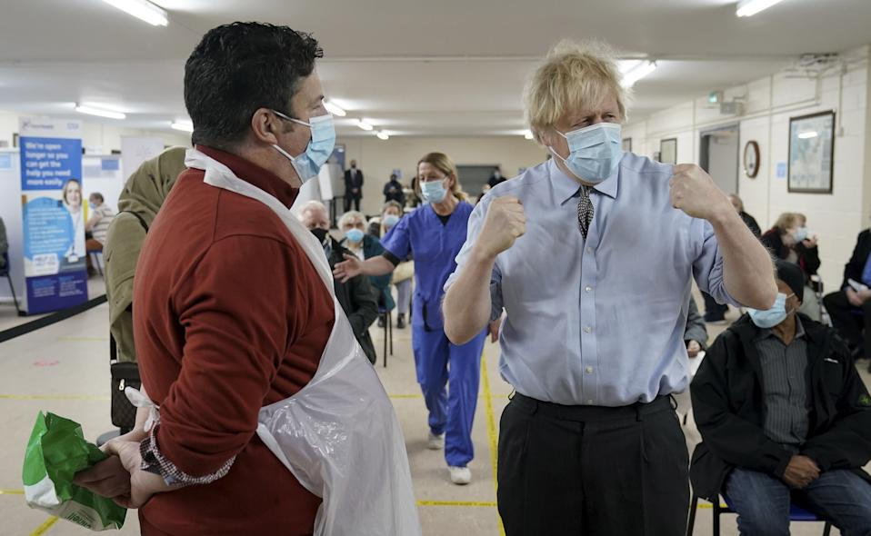 Boris Johnson Boris Johnson talks to Christopher Nicholls who suffered from Covid at the same time as the Prime Minister during a visit to a coronavirus vaccination centre in Batley, West Yorkshire. Picture date: Monday February 1, 2021.