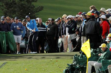 Henrik Stenson of Sweden chips from the crowd onto the 18th green during the 2017 Masters in Augusta