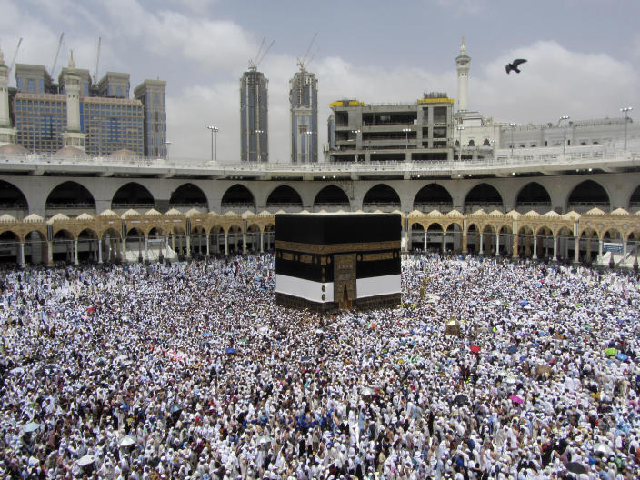 FILE - In this Thursday, Aug. 8, 2019 file photo, Muslim pilgrims circumambulate around the Kaaba, the cubic building at the Grand Mosque, ahead of the Hajj pilgrimage in the Muslim holy city of Mecca, Saudi Arabia. Over 2 million Muslims from around the world are beginning the five-day hajj pilgrimage on Friday. On the first day of the hajj, Muslims circle the Kaaba counter-clockwise seven times while reciting supplications to God, then walk between the two hills traveled by Hagar. (AP Photo/Amr Nabil, File)
