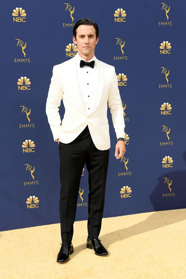 <p>Instead of going with the traditional black or blue tux, our favorite TV dad opted for a white blazer and shirt. </p>