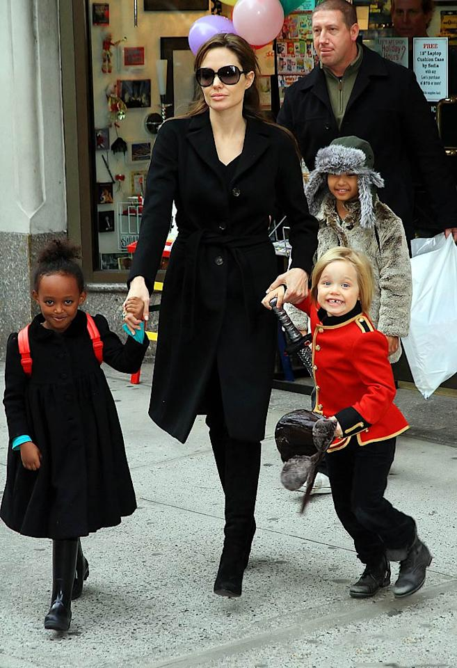 """The Jolie-Pitt clan are well-practiced world travelers, regularly jetting from Europe to Africa, and then back to the USA all in one vacation! Angelina Jolie was spotted hitting up Lee's art shop in NYC with Zahara, Maddox, and Shiloh last month. Jackson Lee/<a href=""""http://www.splashnewsonline.com"""" target=""""new"""">Splash News</a> - December 7, 2010"""