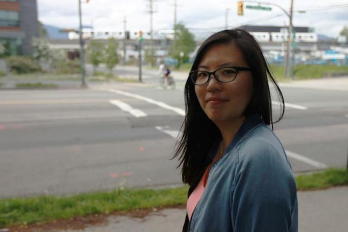 Trixie Ling poses at the Vancouver location where in early May 2020 a man spat on her face after hurling racist insults (AFP Photo/David P. BALL)