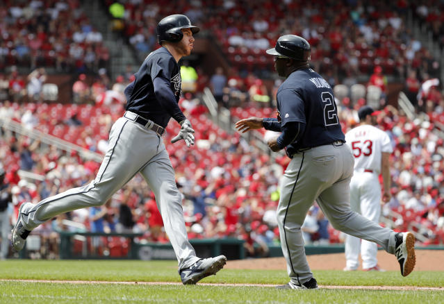 Atlanta Braves' Freddie Freeman, left, is congratulated by first base coach Eric Young while rounding the bases after hitting a two-run home run off St. Louis Cardinals starting pitcher John Gant, right, during the sixth inning of a baseball game Sunday, July 1, 2018, in St. Louis. (AP Photo/Jeff Roberson)