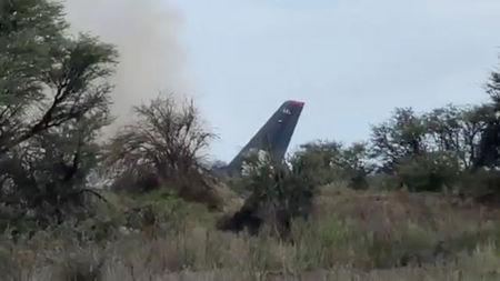 Plane carrying over 100 people crashes in Mexico