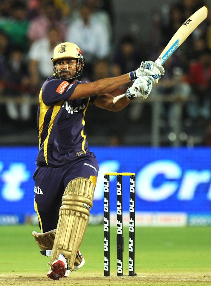Kolkata Knight Riders batsman Yusuf Pathan plays a shot during the IPL Twenty20 first playoff cricket match between Delhi Daredevils and Kolkata Knight Riders at The Subrata Roy Sahara Stadium in Pune on May 22, 2012.  RESTRICTED TO EDITORIAL USE. MOBILE USE WITHIN NEWS PACKAGE    AFP PHOTO/Indranil MUKHERJEE        (Photo credit should read INDRANIL MUKHERJEE/AFP/GettyImages)