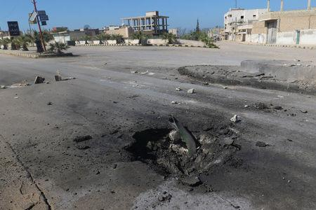 A crater is seen at the site of an airstrike, after what rescue workers described as a suspected gas attack in the town of Khan Sheikhoun in rebel-held Idlib