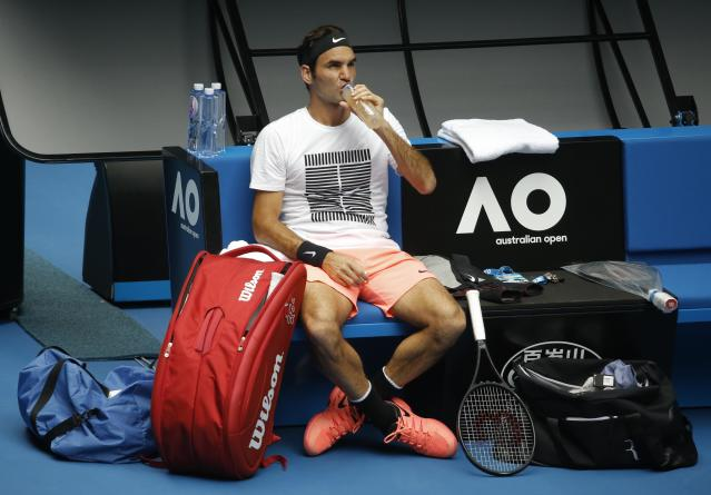 Tennis - Australian Open - Melbourne, Australia, January 13, 2018. Roger Federer of Switzerland has a drink during a break at a practice session ahead of the Australian Open tennis tournament. REUTERS/Thomas Peter