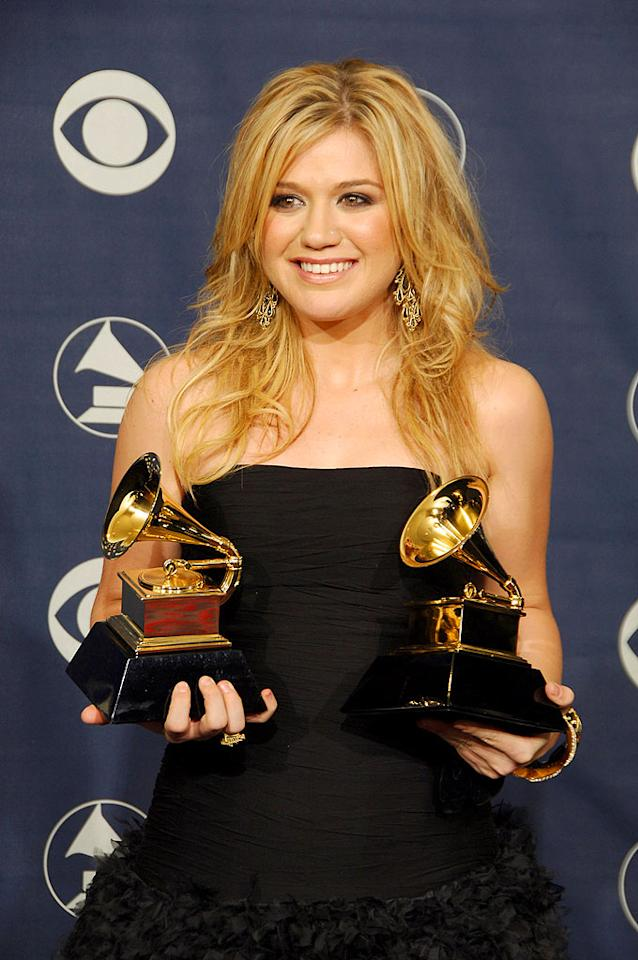 "Original ""American Idol"" winner Kelly Clarkson double-fists some Grammy's. Steve Granitz/<a href=""http://www.wireimage.com"" target=""new"">WireImage.com</a> - February 8, 2006"