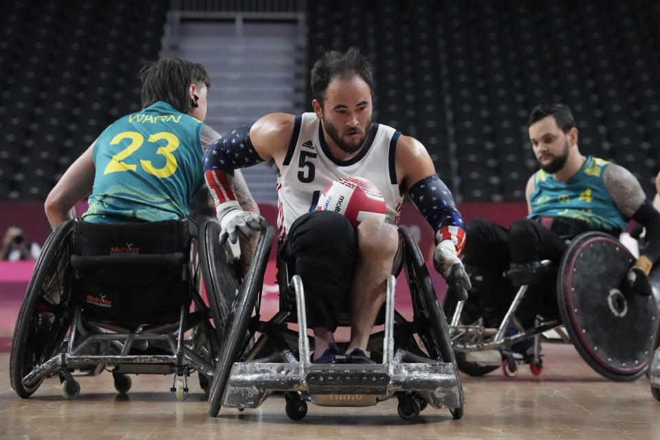 United States' Charles Aoki compete during a semifinal wheelchair rugby match against Australia at the Tokyo 2020 Paralympic Games, Saturday, Aug. 28, 2021, in Tokyo, Japan. (AP Photo/Kiichiro Sato)