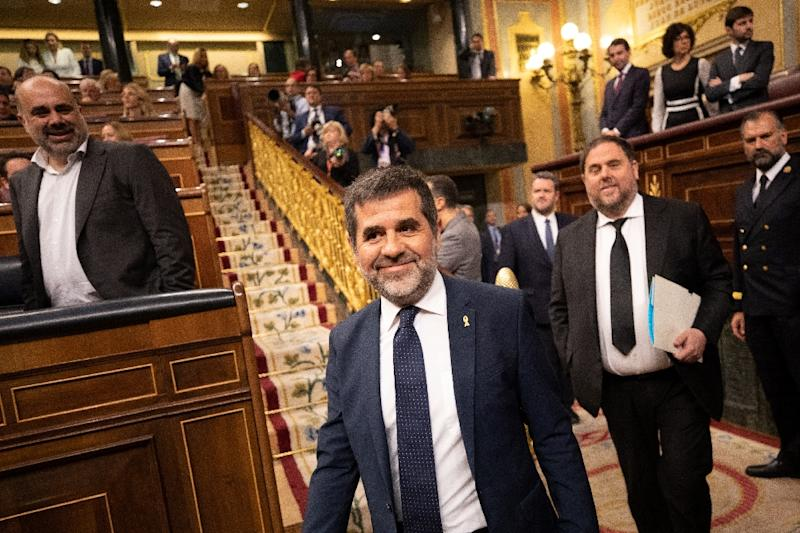 Jailed Catalan elected members of parliament Jordi Sanchez (2L) and Oriol Junqueras (2R) attend the plenary session of the lower house of parliament since last month's general election in Madrid on May 21, 2019