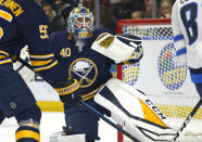 Buffalo Sabres goalie Carter Hutton (40) makes a glove-save during the first period of an NHL hockey game against the Winnipeg Jets, Sunday, Feb. 10, 2019, in Buffalo N.Y. (AP Photo/Jeffrey T. Barnes)