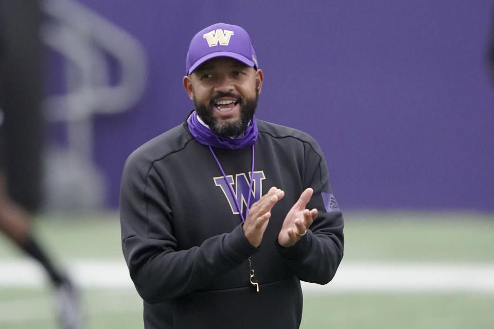 Washington head coach Jimmy Lake calls to his team during NCAA college football practice, Friday, Oct. 16, 2020, in Seattle. (AP Photo/Ted S. Warren)