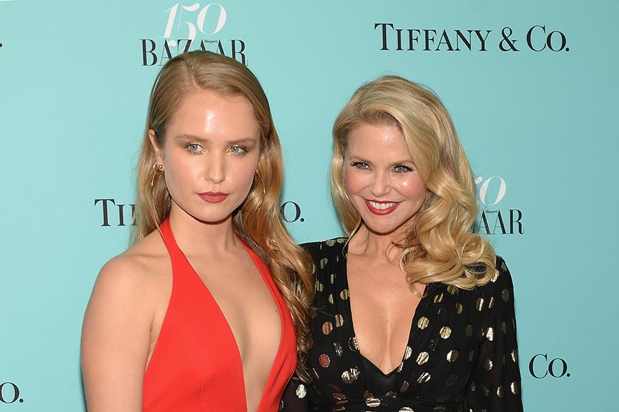 <p>Sailor and her mom, Christie, look like twins with their luminous complexions, loose curls, and red lips at the <em>Harper's Bazaar</em> 150th anniversary event. (Photo by Andrew Toth/Getty Images for Harper's Bazaar) </p>