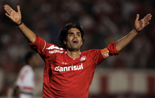 **FILE** In this Aug.16, 2006 file photo, Fernandao of Internacional celebrates after scoring against Sao Paulo FC at the Beira Rio Stadium in Porto Alegre, Brazil. The Brazilian football team Internacional says former striker and coach Fernando Lucio da Costa, better known as Fernandao, has died in a helicopter crash.The team says on its website that the 36-year old Fernandao was one of five passengers killed when the helicopter crashed early Saturday in the state of Goias, where he had a house.(AP Photo/Silvia Izquierdo-FILE)