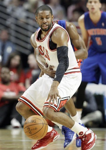 Chicago Bulls guard C.J. Watson, foreground, controls the ball as Detroit Pistons guard Brandon Knight (7) guards during the first half of an NBA basketball game in Chicago, Friday, March 30, 2012. (AP Photo/Nam Y. Huh)